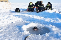 Ice Camp Skate (March 16, 2018) – Chief Hospital Corpsman Kristopher Mandaro, assigned to Underwater Construction Team One (UCT 1), surfaces from a waterhole during a torpedo exercise in the Arctic Circle in support of Ice Exercise (ICEX) 2018, March 16. ICEX 2018 is a five-week exercise that allows the Navy to assess its operational readiness in the Arctic, increase experience in the region, advance understanding of the Arctic environment, and continue to develop relationships with other services, allies and partner organizations. (U.S. Navy photo by Mass Communication Specialist 1st Class Daniel Hinton)