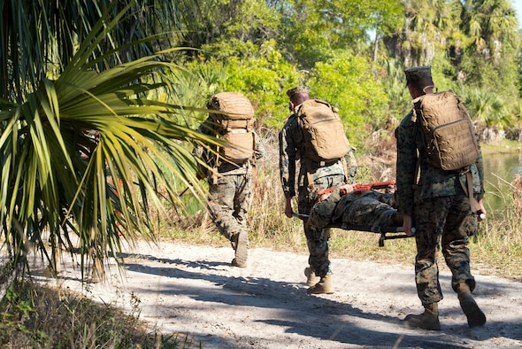 U.S. Marines carry a simulated victim during a U.S. Marine Corps Forces Central Command noncommissioned officer field exercise at MacDill Air Force Base, Fla., March 14-15, 2018. As part of the exercise, Marines participated in various practical scenarios such as land navigation, patrolling and medical emergencies.