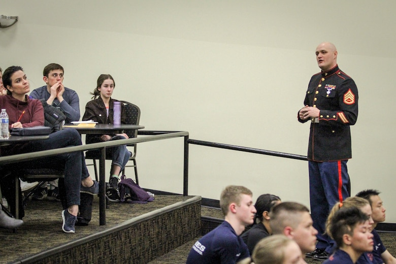 Staff Sgt. Shawn Dundee, staff noncommissioned officer-in-charge, Recruiting Substation Des Moines, speaks to parents of those who recently enlisted in the Marine Corps during the station's annual Drill Instructor Family Night at Events Center West in West Des Moines, Iowa, March 23, 2018. Marine Corps Recruiting Command hosts the family nights to better prepare both parent and enlistee prior to attending Marine Corps Recruit Training. (Official U.S. Marine Corps photo by Sgt. Levi Schultz)
