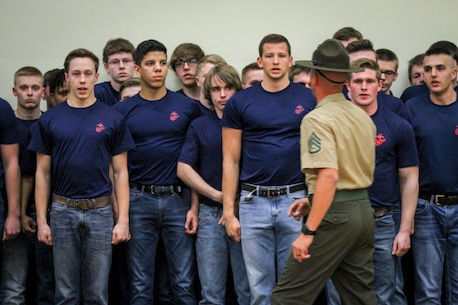 Individuals from the Des Moines area who have recently enlisted in the Marine Corps attempt to follow commands from Staff Sgt. John Leech, drill instructor, 1st Recruit Training Regiment, during a Drill Instructor Family Night at Events Center West in West Des Moines, Iowa, March 23, 2018. Marine Corps Recruiting Command hosts the family nights to better prepare both parent and enlistee prior to attending Marine Corps Recruit Training. (Official U.S. Marine Corps photo by Sgt. Levi Schultz)