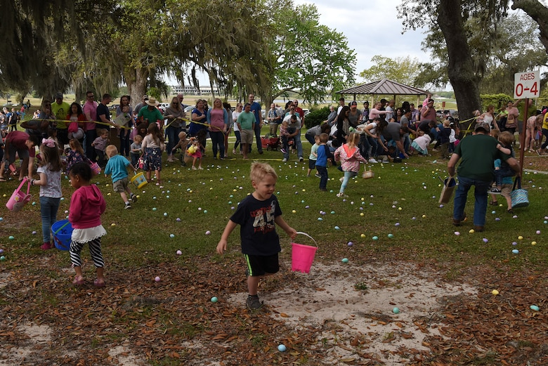Keesler children participate in an Easter egg hunt during Easter in the Park at Marina Park March 24, 2018, on Keesler Air Force Base, Mississippi. The event festivities also included a parade, arts and crafts and informational booths. (U.S. Air Force photo by Airman 1st Class Suzie Plotnikov)