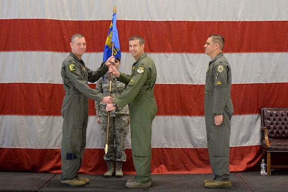 Col. David Smith, 419th Fighter Wing commander, passes the group flag to Col. Sean Carpenter, the new commander of the 419th Operations Group