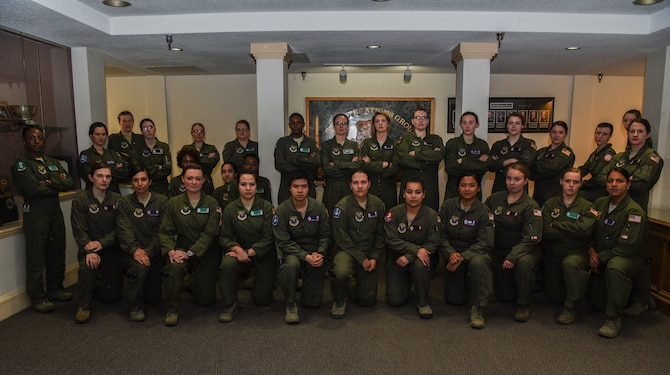 The all-female alert crew prepares to trip out to the missile field for the third year at F.E. Warren Air Force Base, Missile Complex, March 25, 2018. For 24 hours across 20th Air Force, women held the key to air power by having all-female missile alert crews for the third year at all facilities. The purpose of the all-female alert was to recognize female history and to honor the first female to pull alert on the Minuteman III ICBM. (U.S. Air Force photo by Airman 1st Class Abbigayle Wagner)