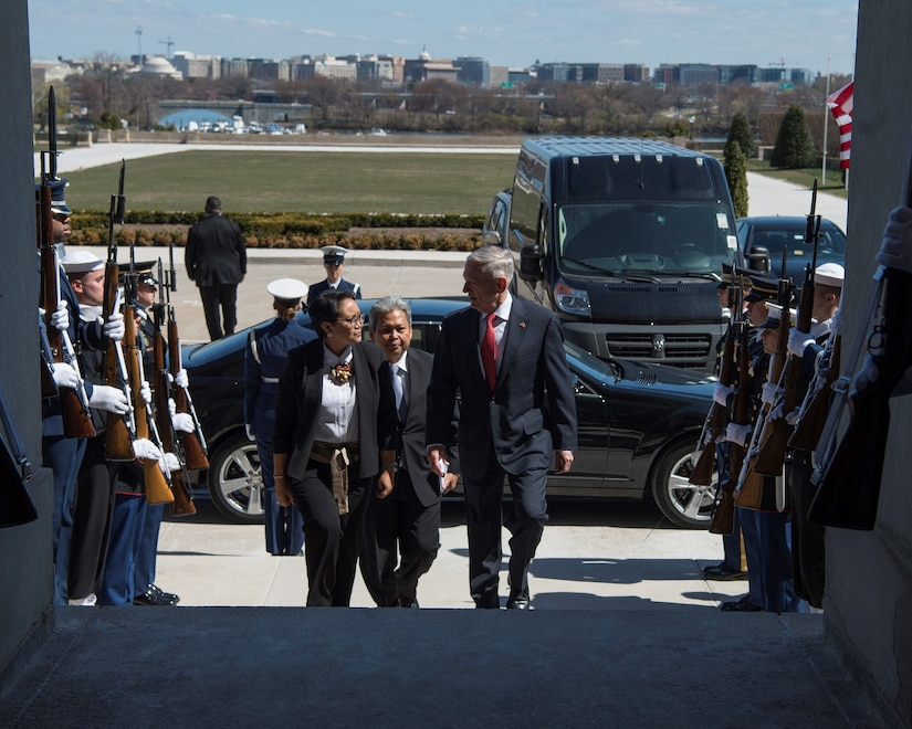 Defense Secretary James N. Mattis, right, and Indonesian Foreign Minister Retno Marsudi enter the Pentagon.