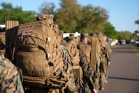 U.S. Marines ruck during a U.S. Marine Corps Forces Central Command noncommissioned officer (NCO) field exercise at MacDill Air Force Base, Fla., March 14-15, 2018. The exercise consisted of classes and practical applications focused on developing skills as an NCO.