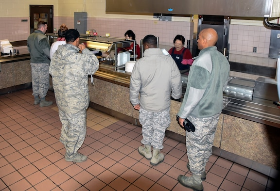 U.S. Air Force Airmen wait in line to get served during dinner, Jan. 24, 2018, at Kunsan Air Force Base, Republic of Korea. The dining facility staff are responsible of serving nearly 2,000 U.S. service members and any cash paying customer on a daily basis. (U.S. Air Force photo by Senior Airman Colby L. Hardin)
