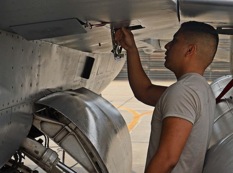 Senior Airman Kevin Zaragoza, 455th Expeditionary Aircraft Maintenance Squadron F-16 Fighting Falcon crew chief, inspects a gear box on an F-16 Mar. 20, 2018 at Bagram Airfield, Afghanistan.