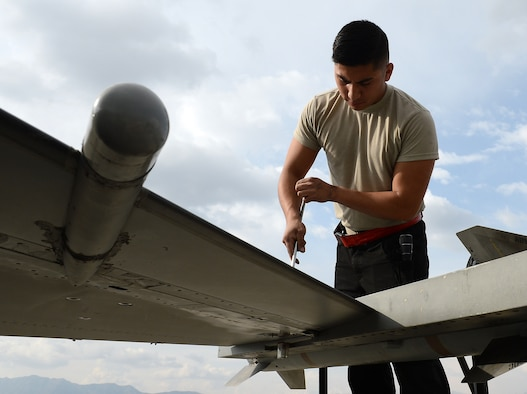 Senior Airman Kevin Zaragoza, 455th Expeditionary Aircraft Maintenance Squadron F-16 Fighting Falcon crew chief, tightens up a screw on the wing of an F-16 Mar. 20, 2018 at Bagram Airfield, Afghanistan.