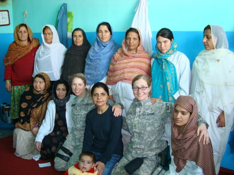 Lt. Col. Elizabeth Erickson (first row, second from right), a U.S. Air Force physician, poses for a photo with Afghan women healthcare providers and Staff Sgt. Sarah Saelens when she worked on the Zabul Provincial Reconstruction Team. The PRT worked closely with local healthcare providers to improve the health and wellbeing of Afghan women. (Courtesy photo)