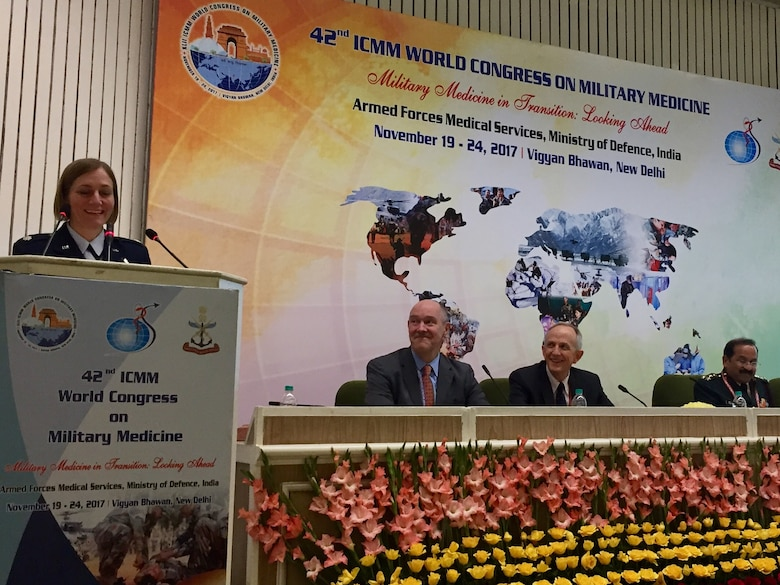 Lt. Col. Elizabeth Erickson, a U.S. Air Force physician, speaks at the International Committee of Military Medicine along with Dr. J. Christopher Daniel and Dr. David Smith from the U.S. delegation in New Delhi, India, November 2017. Erickson spoke on research she had done relating to military medicine, and was the only female among the 9-person U.S. delegation. (Courtesy photo)