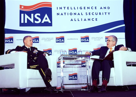 Defense Intelligence Agency (DIA) Director, LTG Robert P. Ashley and former acting DIA director David R. Shedd confer during the Intelligence and National Security Alliance (INSA) Leadership Dinner at the Renaissance Arlington Capital View Hotel, Arlington, VA, Thursday, March 8, 2018. Photo courtesy of INSA, © 2018 Herman Farrer Photography.