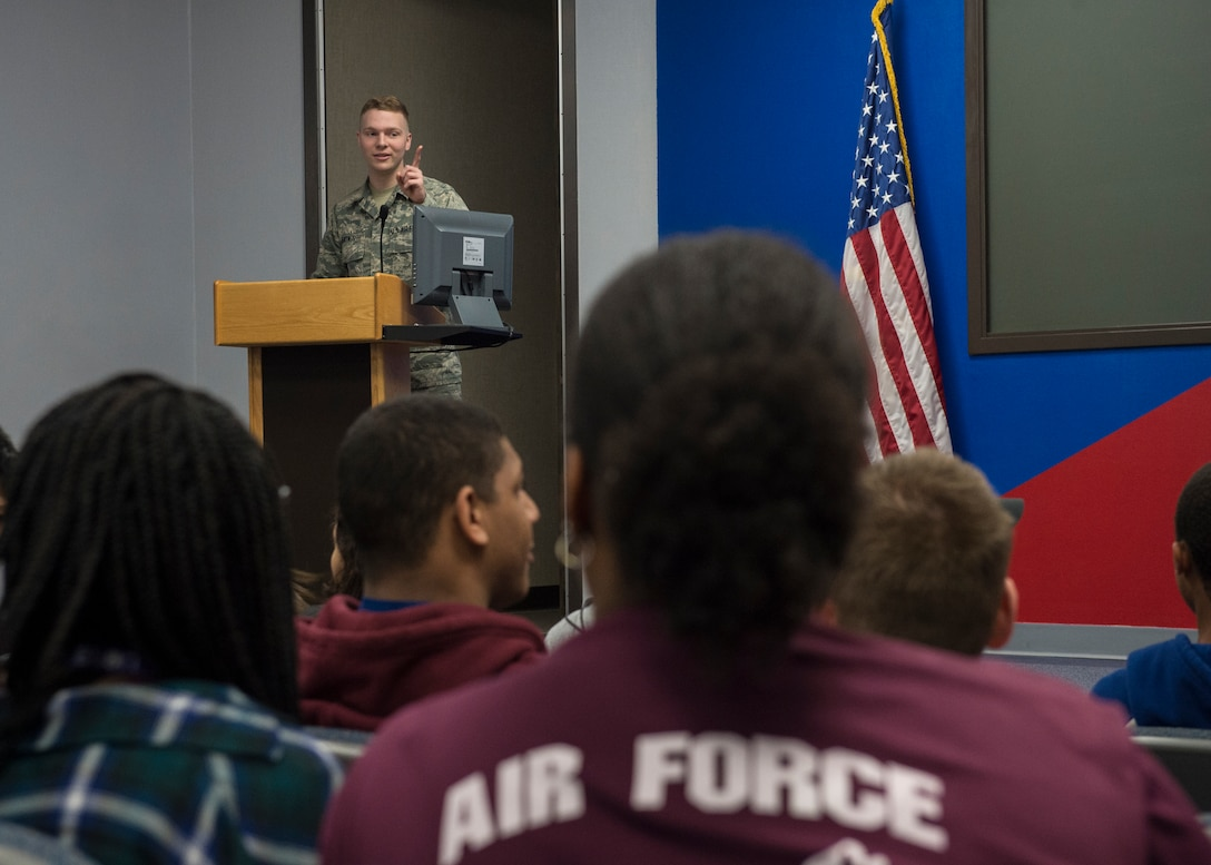 U.S. Air Force Airman Jeremy Wentworth, a photojournalist assigned to the 97th Air Mobility Wing Public Affairs, briefs about the history of Altus Air Force Base to Air Force Junior ROTC cadets from Timberview High School, Texas, March 23, 2018, at Altus AFB, Okla. The Junior ROTC is a program sponsored by the United States Armed Forces in high schools and middle schools across the country, which helps develop students interested in joining the military.  (U.S. Air Force photo by Senior Airman Kirby Turbak)