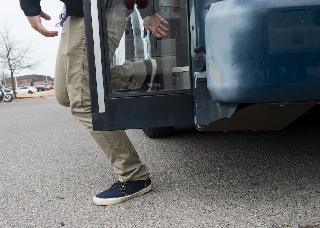 An Air Force Junior ROTC cadet from Timberview High School, Texas, walks off a bus while touring Altus Air Force Base, March 23, 2018, at Altus AFB, Okla. The Junior ROTC is a program sponsored by the United States Armed Forces in high schools and middle schools across the country which, helps develop students interested in joining the military.  (U.S. Air Force photo by Senior Airman Kirby Turbak)