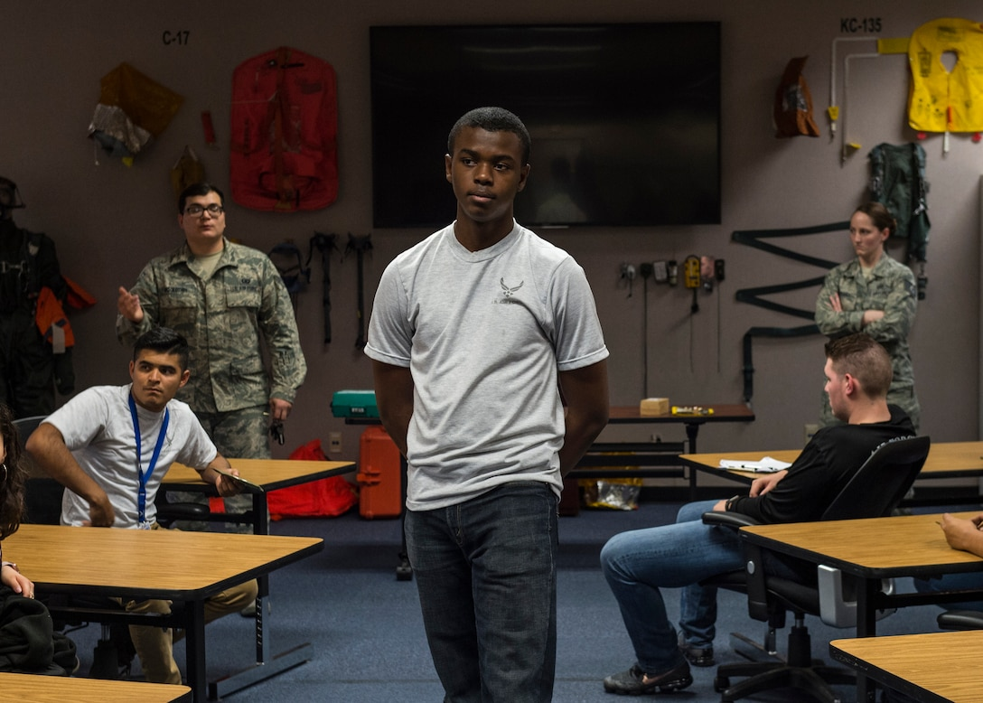 An Air Force Junior ROTC cadet from Timberview High School, Texas, stands while being told about different equipment used by aircrews, March 23, 2018, at the Aircrew Flight Equipment flight, Altus Air Force Base, Okla. The Junior ROTC is a program sponsored by the United States Armed Forces in high schools and middle schools across the country which helps develop students interested in joining the military.  (U.S. Air Force photo by Senior Airman Kirby Turbak)