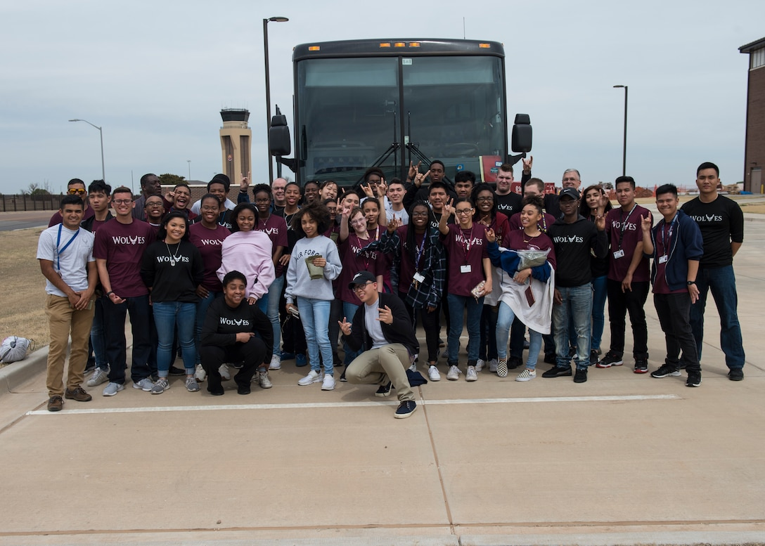 Air Force Junior ROTC cadets from Timberview High School, Texas, take a group photo after getting a tour of the base, March 23, 2018, at Altus Air Force Base, Okla. The Junior ROTC is a program sponsored by the United States Armed Forces in high schools and middle schools across the country which helps develop students interested in joining the military.  (U.S. Air Force photo by Senior Airman Kirby Turbak)