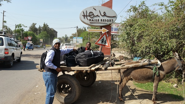 Yared Amanuel, right, retrieves his luggage after his arrival in Hawassa, Ethiopia, on March 9, 2018. Amanuel, an engineer at Naval Surface Warfare Center, Carderock Division, was in Ethiopia on personal travel to help run his non-profit organization, EthioAthletics, which he normally does from his home in Maryland.