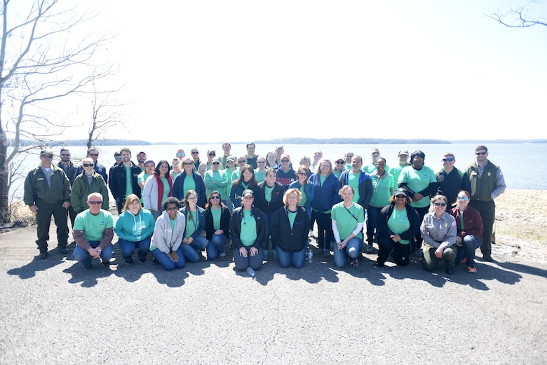 Corps of Engineers park rangers pose with VF Solutions who volunteered for an early Earth Day clean-up event March 22, 2018 at Seven Points Campground on the shoreline of J. Percy Priest Lake in Hermitage, Tenn. Sixty VF Solutions employees partnered with the U.S. Army Corps of Engineers Nashville District to spruce up the popular campground ahead of the 2018 recreation season. (USACE photo by Lee Roberts)