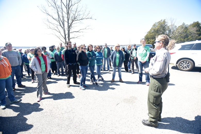 Park Ranger Amber Jones directs 60 volunteers from VF Solutions for an early Earth Day clean-up event March 22, 2018 at Seven Points Campground on the shoreline of J. Percy Priest Lake in Hermitage, Tenn. The VF Solutions employees partnered with the U.S. Army Corps of Engineers Nashville District to spruce up the popular campground ahead of the 2018 recreation season. (USACE photo by Lee Roberts)