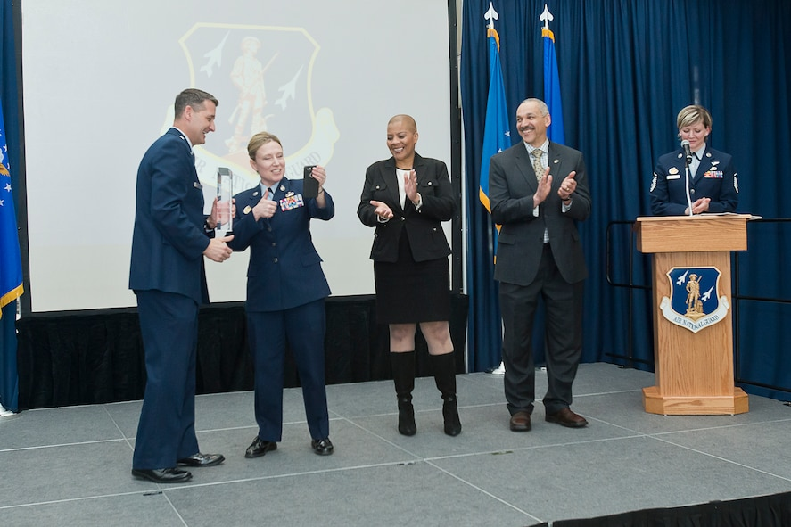 Brig. Gen. Steven Nordhaus and Chief Master Sgt. Lorraine Regan congratulate annual award winners via video chat at the Air National Guard Readiness Center annual awards ceremony, held March 22, 2018, at the ANGRC on Joint Base Andrews, Md. (U.S. Air National Guard photo/Tech. Sgt. John E. Hillier)