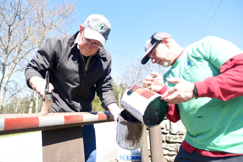 James Paul (Left), director of product customization; and Andy Rabiner, manager of Horace Small Brand public safety uniforms; with VF Solutions, paints a roadway gate while volunteering for an early Earth Day clean-up event March 22, 2018 at Seven Points Campground on the shoreline of J. Percy Priest Lake in Hermitage, Tenn. Sixty VF Solutions employees partnered with the U.S. Army Corps of Engineers Nashville District to spruce up the popular campground ahead of the 2018 recreation season. (USACE photo by Lee Roberts)