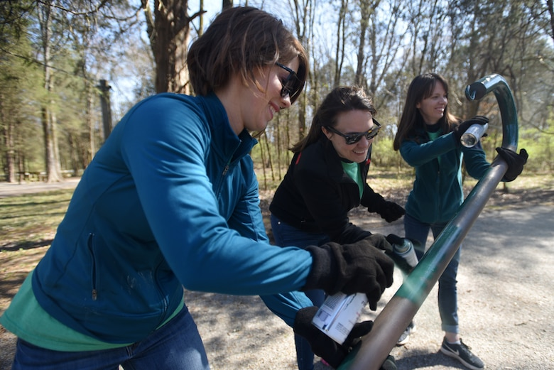 (Left to Right) Amy Gardner, merchandizing manager; Katy Green, merchandizer; and Cassie McLure, merchandizer; with VF Solutions, paint a utility post while volunteering for an early Earth Day clean-up event March 22, 2018 at Seven Points Campground on the shoreline of J. Percy Priest Lake in Hermitage, Tenn. Sixty VF Solutions employees partnered with the U.S. Army Corps of Engineers Nashville District to spruce up the popular campground ahead of the 2018 recreation season. (USACE photo by Lee Roberts)