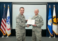 U.S. Air Force General Joseph L. Lengyel, Chief of the National Guard Bureau and member of the Joints Chiefs of Staff, presents the Defense Meritorious Service Medal to Senior Master Sgt. Chad Jones before addressing Air National Guard Airmen and civilians March 26, 2018 at Joint Base Andrews, Maryland. (Air National Guard photo by Master Sgt. Marvin R. Preston/Released)