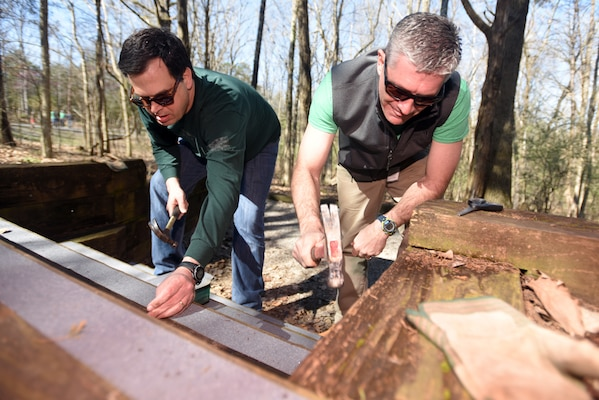 Pat Kopf (Right), chief finance officer with V.F. Workwear, and Keith Steward, vice president of customer relations with VF Solutions, install traction strips on wood steps at a campsite while volunteering for an early Earth Day clean-up event March 22, 2018 at Seven Points Campground on the shoreline of J. Percy Priest Lake in Hermitage, Tenn. Sixty VF Solutions employees partnered with the U.S. Army Corps of Engineers Nashville District to spruce up the popular campground ahead of the 2018 recreation season. (USACE photo by Lee Roberts)