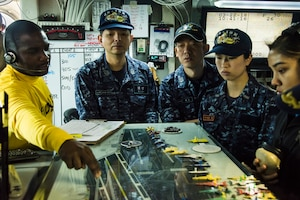 U.S. and Japanese sailors tour Japanese naval vessel.