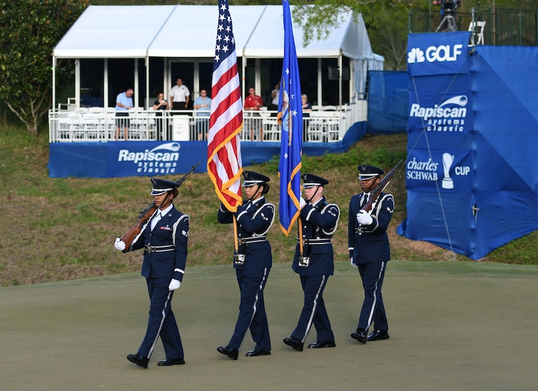 The Keesler Honor Guard presents the colors during the Rapiscan Systems Classic Champions Tour at Fallen Oak Golf Club March 25, 2018, in Saucier, Mississippi. Keesler personnel performed the national anthem and presented the colors during the closing ceremony of the three-day event. (U.S. Air Force photo by Kemberly Groue)