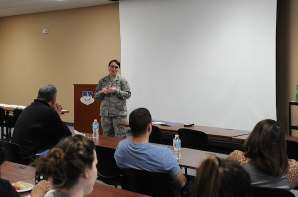 Chief Master Sgt. Amber Mitchell, 341st Missile Wing command chief, speaks to spouses at a Let's Talk Malmstrom Spouses event March 26, 2018, at Malmstrom Air Force Base, Mont. Let's Talk is a monthly event geared toward providing professional and personal development for military spouses. The next Let's Talk event is scheduled April 30 at 6 p.m. at the Circle. (U.S. Air Force photo by Christy Mason)