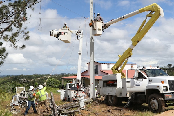 Despite the rugged terrain, power workers with the U.S. Army Corps of Engineers reconnect power lines near the town of Lares, Puerto Rico, Jan. 24, 2018. An estimated 80 percent of the power grid in Puerto Rico was destroyed by Hurricane Maria in September. Army photo by Preston Chasteen