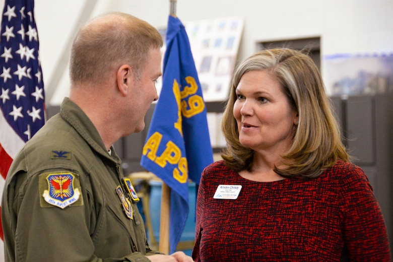 Col. James DeVere, the 302nd Airlift Wing commander, speaks with Kristen Christy, the Colorado Springs Chamber & EDC's Military Affairs Council vice chair, during the Area Chiefs of Staff luncheon held at Peterson Air Force Base, Colorado March 21, 2018.