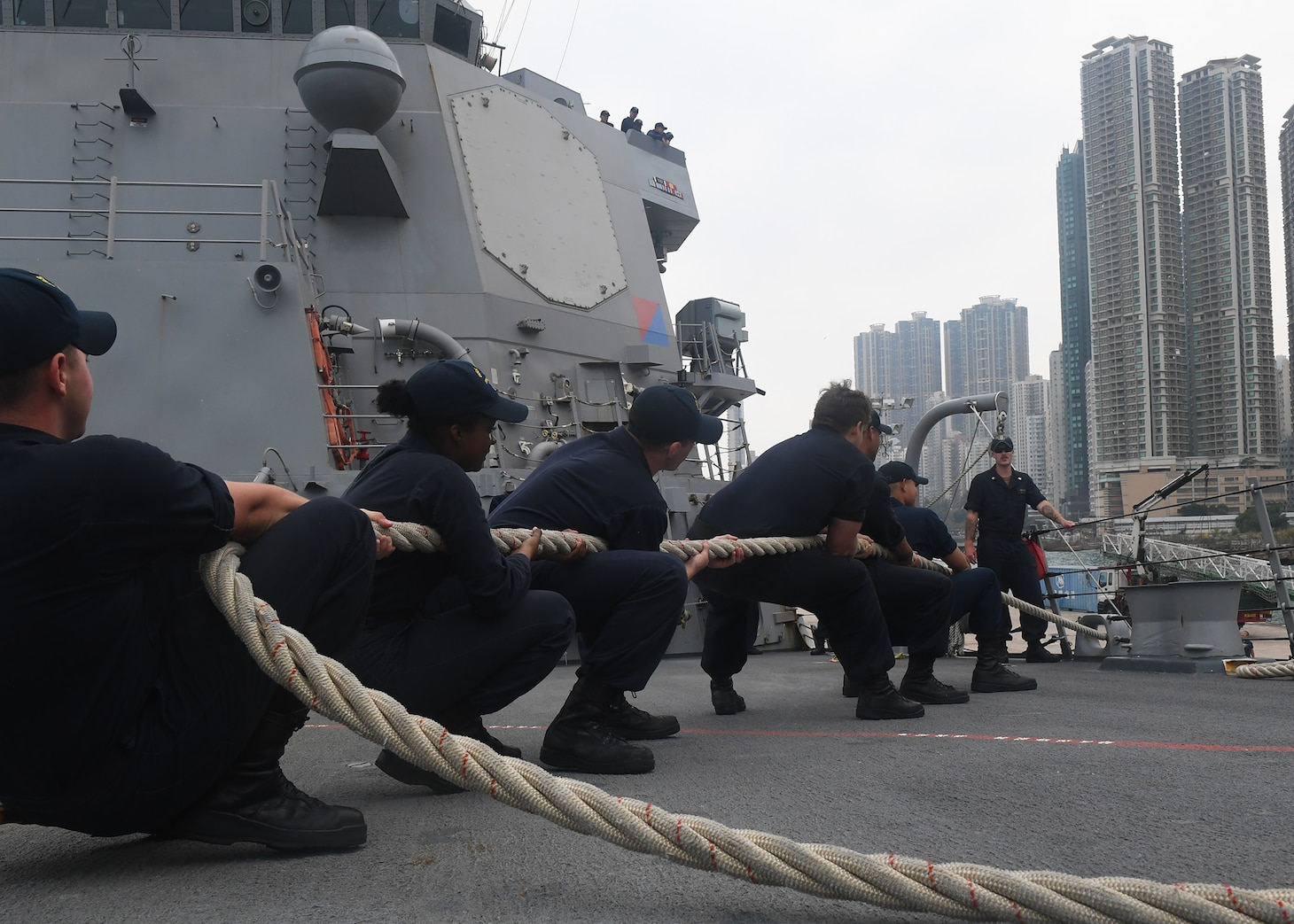 Sailors heave a line aboard the Arleigh Burke-class guided-missile destroyer USS Sterett (DDG 104) as part of a scheduled port visit. Sterett is in Hong Kong to experience the city's rich culture and history as the guided-missile destroyer continues its deployment with the Wasp Expeditionary Strike Group as a multi-mission asset in the Indo-Pacific region.