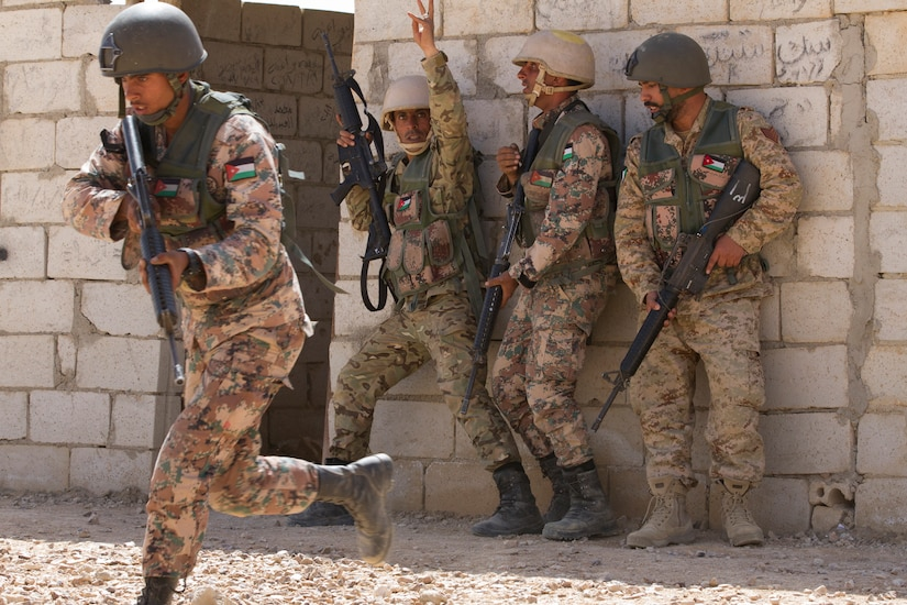Jordanian and Kuwaiti soldiers conduct a stack prior to clearing a room during a simulated assault, part of the Jordan Armed Forces Noncommissioned Officer Academy Squad Leader Course, March 21, 2018, near Amman, Jordan. U.S. advisors assisted in the development of the Jordanian-led course.