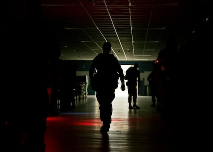 Marine Officer Candidates prepare for a hike as part of the Mini-Officer Candidate School (OCS) aboard Marine Corps Recruit Depot Parris Island, South Carolina, Mar. 24, 2018. The Mini-OCS gives candidates a small example of the hardships that await them at the school. (U.S. Marine Corps photo by Lance Cpl. Jack A. E. Rigsby)