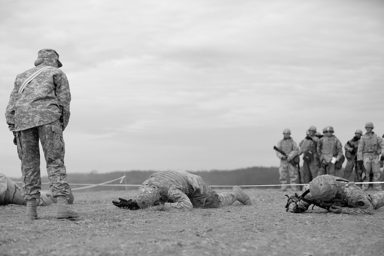 U.S. Army Reserve Soldiers, assigned to the 327th Quartermaster Battalion, based in Williamsport, Pennsylvania, conduct low crawling techniques in response to simulated direct fire, ahead of their lanes training validation, during Combat Support Training Exercise 78-18-03, at Fort Knox, Kentucky, Mar. 19, 2018.