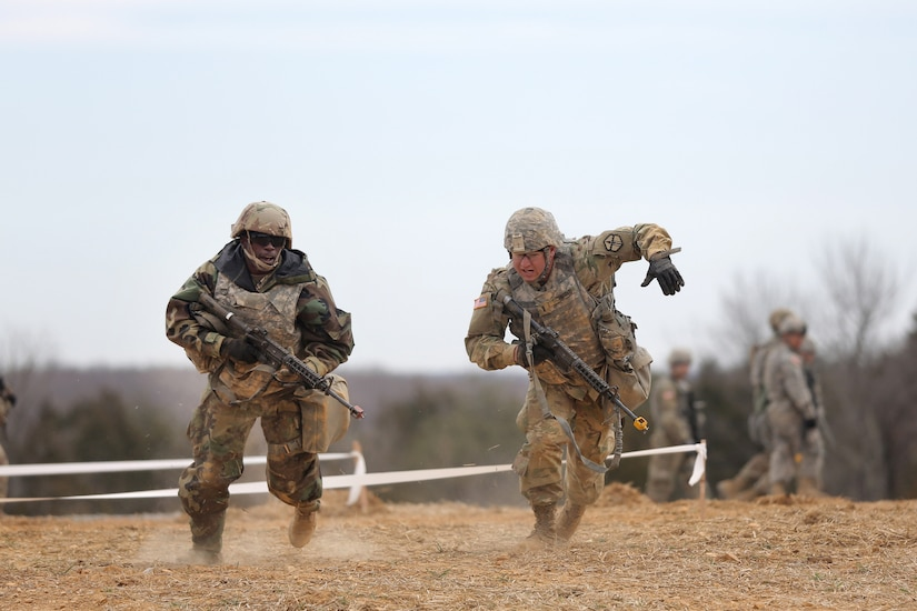U.S. Army Reserve Soldiers, assigned to the 301st Maneuver Enhancement Brigade, conduct three-to-five second buddy rushes as part of their reacting to direct fire training, ahead of their lanes training validation, during Combat Support Training Exercise 78-18-03, at Fort Knox, Kentucky, Mar. 19, 2018.