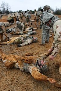 U.S. Army Reserve Soldiers, assigned to the 327th Quartermaster Battalion, based in Williamsport, Pennsylvania, conduct training on transporting a casualty as part of their skill level one tasks, ahead of their lanes training validation, during Combat Support Training Exercise 78-18-03, at Fort Knox, Kentucky, Mar. 20, 2018.
