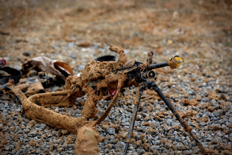 An M249 light machine gun sits, caked in mud, during skill level one task training, ahead of lanes training validation at the Army Reserve's Combat Support Training Exercise 78-18-03, at Fort Knox, Kentucky, Mar. 20, 2018.