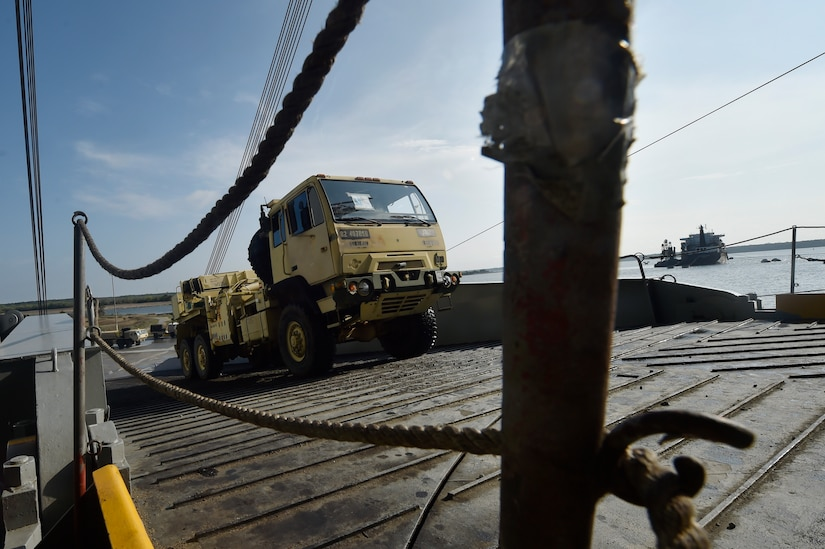 Vehicles assigned to the 82nd Airborne Division are loaded onto the USNS Watson (T-AKR-310) in preparation for transport at Joint Base Charleston's - Weapons Station, S.C., March 20. The 841st Transportation Battalion, 597th Transportation Brigade, on-loaded more than 1,500 vehicles and equipment, including combat helicopters. Charleston has the capability to transport cargo by air, land, rail and sea.