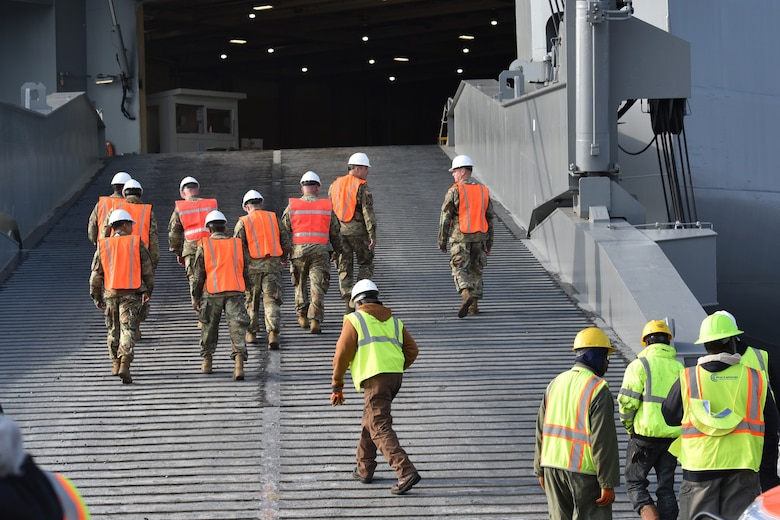 U.S. Army Soldiers board the USNS Watson (T-AKR-310) prior to on-loading vehicles assigned to the 82nd Airborne Division at Joint Base Charleston's - Weapons Station, S.C., March 20. The 841st Transportation Battalion, 597th Transportation Brigade, on-loaded more than 1,500 vehicles and equipment, including combat helicopters. Charleston has the capability to transport cargo by air, land, rail and sea.