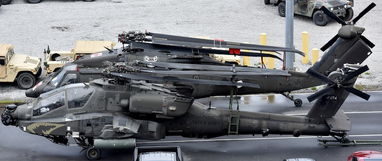 U.S. Army helicopters assigned to the 82nd Airborne Division are placed alongside the USNS Watson (T-AKR-310) prior to being on-loaded at Joint Base Charleston's - Weapons Station, S.C., March 20. The 841st Transportation Battalion, 597th Transportation Brigade, on-loaded more than 1,500 vehicles and equipment, including combat helicopters. Charleston has the capability to transport cargo by air, land, rail and sea.