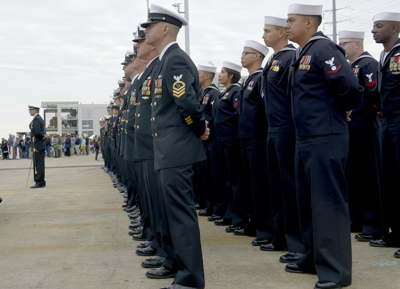 The crew that will man the USS Ralph Johnson (DDG-114) stands in formation during the commissioning ceremony March 24, 2018, in the Port of Charleston, S.C.