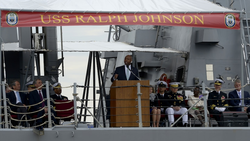 Sen. Tim Scott of South Carolina delivers remarks during the USS Ralph Johnson (DDG-114) commissioning ceremony March 24, 2018 at the Port of Charleston, S.C.