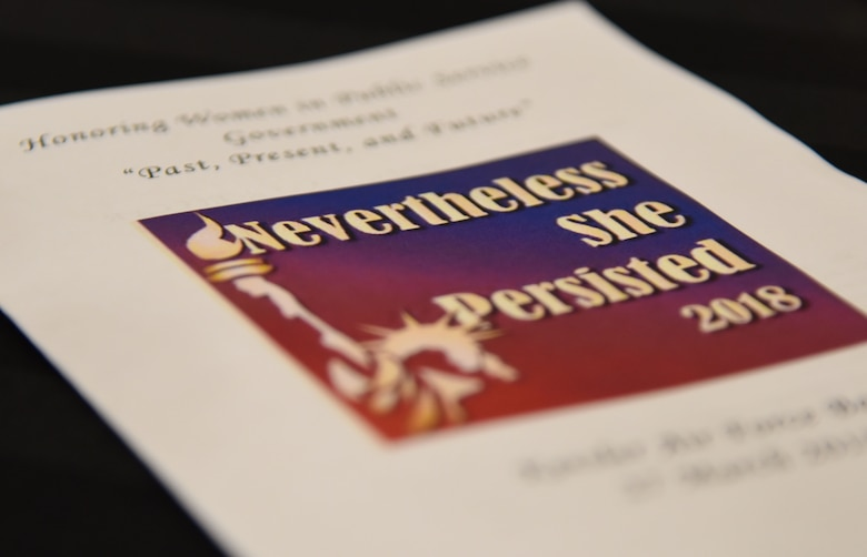 """An event program is on display during the Women's History Month Luncheon at the Bay Breeze Event Center March 27, 2018, on Keesler Air Force Base, Mississippi. The theme for this year's event is """"Nevertheless She Persisted."""" (U.S. Air Force photo by Kemberly Groue)"""
