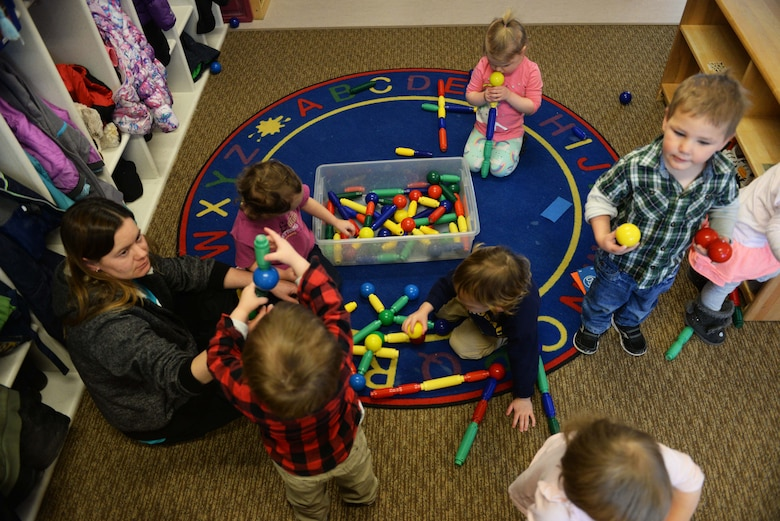 Crystal Emmons, a program technician at the McRaven Child Development Center, plays with the children in her classroom at Ellsworth Air Force Base, S.D., Feb. 6, 2018. The CDC on base is one of only five childcare centers in South Dakota that is accredited with the National Association for the Education of Young Children, which is an organization that helps children grow and gives them a chance to be more successful in the future. (U.S. Air Force photo by Airman 1st Class Thomas Karol)