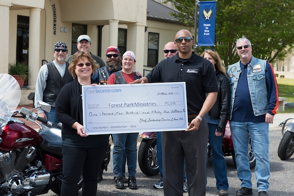 Members of the Air University community donate to local charity