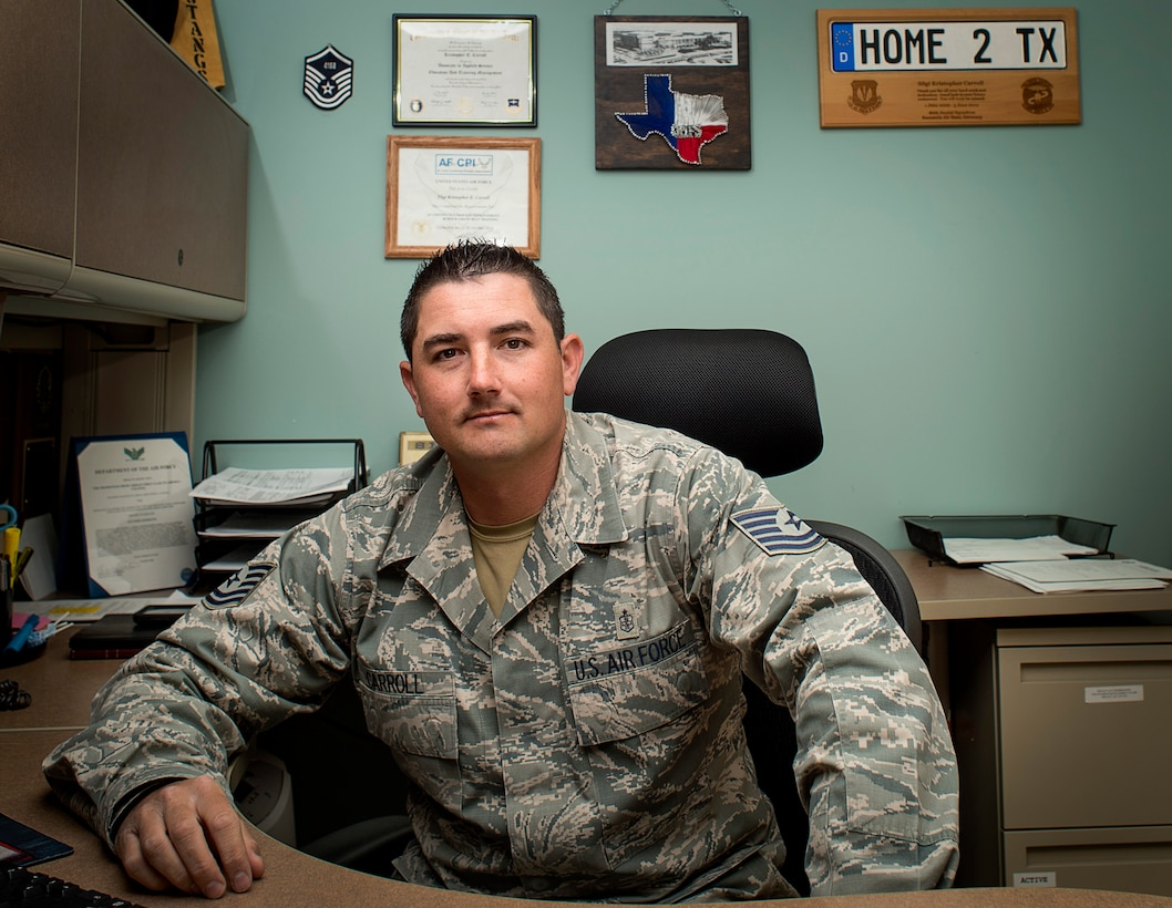 U.S. Air Force Tech. Sgt. Kristopher Carroll, NCO in charge of dental flight assigned to the 97th Medical Operations Squadron, poses for a portrait in his office, March 27, 2018 at Altus Air Force Base, Okla.