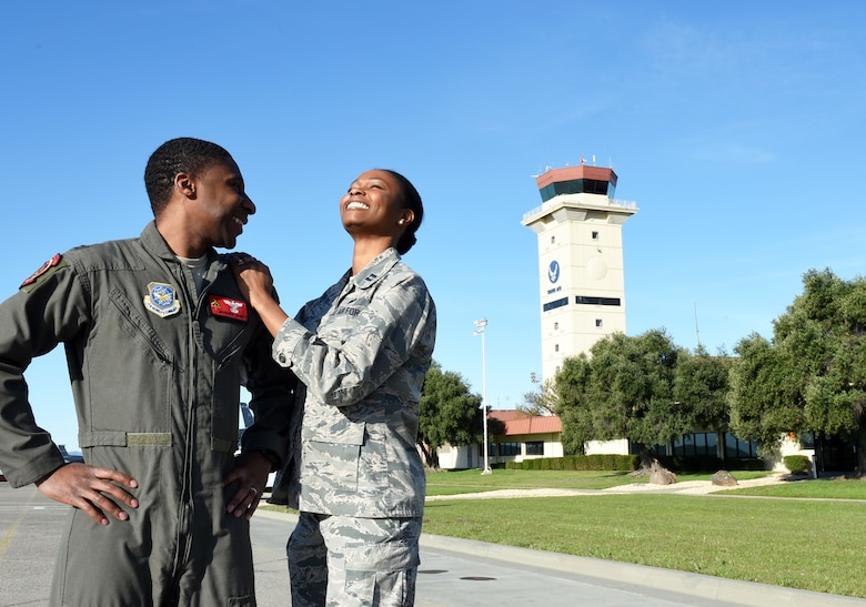 Capt. Aisha Lockett, 60th Air Mobility Wing executive officer, and Capt. Broderick Lockett, 21st Airlift Squadron director of staff, stand together on the flightline at Travis Air Force Base, California, Mar. 27. The Locketts have been at Travis since 2015 and, in that time, have contributed not only to the base's standard of living, but also to its history and legacy. (U.S. Air Force photo by Airman 1st Class Christian Conrad)