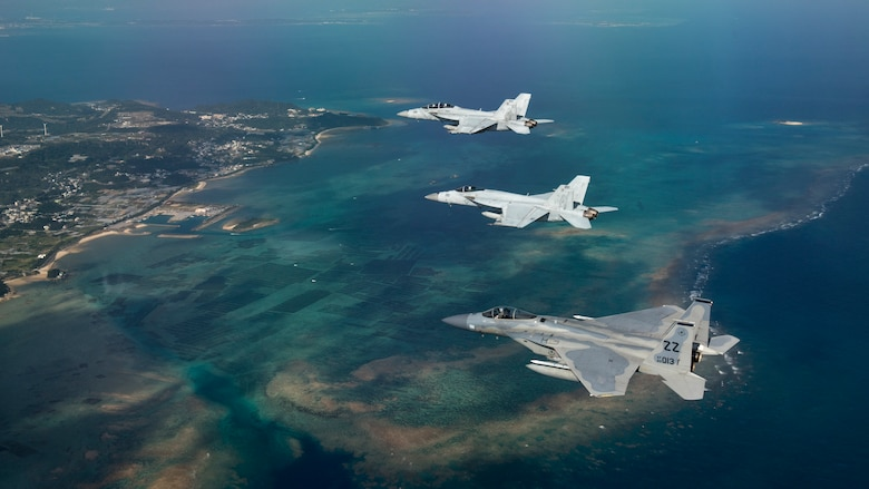 A U.S. Air Force 44th Fighter Squadron F-15 Eagle and U.S. Navy Strike Fighter Squadron 27 and 102 (VFA-27, VFA-102) F/A-18 Super Hornets, assigned to Naval Air Facility Atsugi, Japan, fly in formation after a training sortie Feb. 16, 2017, over the Pacific Ocean. The joint training bolstered communications and interoperability between the two services, which both serve to enhance peace and security throughout the Indo-Asia Pacific Theater. (U.S. Air Force photo by Staff Sgt. Peter Reft/Released)